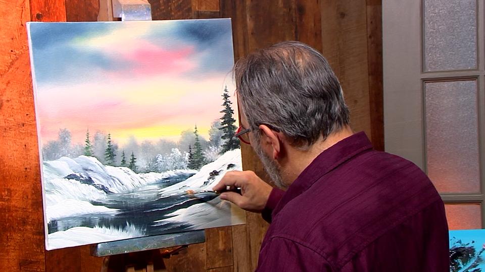 Paysage d'hiver sous un ciel coloré